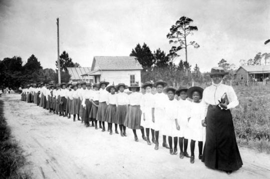 Mary McLeod Bethune with a line of girls from her school: Daytona Beach, Florida. Photo courtesy of Florida Memory
